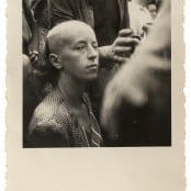 Woman with Shaved Head, France, 19-26 August 1944